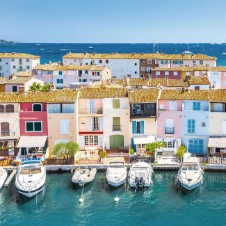View Of Colorful Houses And Boats In Port Grimaud During Summer Day-Port Grimaud